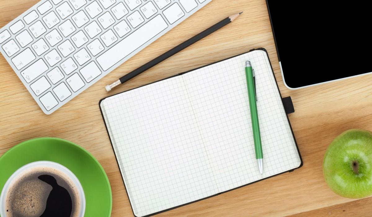 desk aerial view - keyboard, green, coffee, notepad -1200x700.jpg
